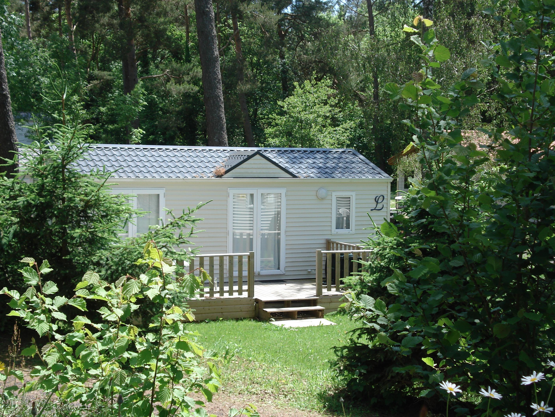 Location - Résidence Grand Large Louisiane Avec Portes Fenetres 4 Personnes Incluses Dans Le Tarif Capacité - Camping du Lac d'Aydat