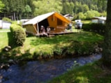 Rental - CONFORT Tente Lodge Nature 25m² (2 bedrooms) + terrace - without private facilities - 2013 - Flower Camping VERTE VALLEE