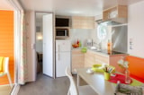 Huuraccommodaties - Cottage Patchwork 34 m² - 2 slaapkamers + 2 badkamers + air co & tv - Camping Holiday Green