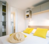 Huuraccommodaties - Cottage Yellow Corner 28 m² - 2 slaapkamers + airconditioning - Camping Holiday Green
