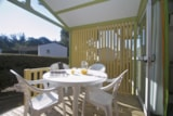 Rental - Chalet Canelle 30m² - 2 bedrooms + sheltered terrace - Camping Côté Plage