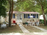 Rental - Mobile Home DELUXE (airconditioning included) 24 m² - 4 Beds + 2 extra persons in the livingroom - 1 bathroom - garden - Camping Villaggio Italgest
