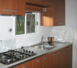 Rental - Mobile Home SUPERIOR 24 m² - 5 Beds + 2 extra persons in the livingroom - 1 bathroom - garden - optional airconditioning - Camping Villaggio Italgest
