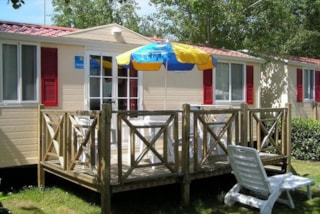 Mobile Home DELUXE (airconditioning included) 26 m² - 5 Beds + 1 extra person in the livingroom - Terrace - 1 bathroom