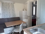 Rental - Mobile Home DELUXE (airconditioning included) 21 m² - 4 Beds + 1 extra person in the livingroom - 1 bathroom - garden - Camping Villaggio Italgest