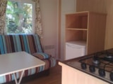 Rental - Mobil-home SAMOA 20m² + wooden floor with sun shelter 7.5 m² - without bathroom - Camping Sites et Paysages LE MAS DU PADRE