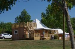 Huuraccommodaties - Sunny Lodge 34m² / 2 slaapkamers - 22m² overdekt terras + 15m² solarium+Airconditioning - CAMPING LES VALADES