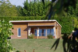 Huuraccommodaties - Chalet Premium 34m² / 2 slaapkamers - 12m² overdekt terras+ Airconditioning - CAMPING LES VALADES