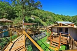 Rental - Wooden cabin Lodge on piles 23 m² / 2 bedrooms - sheltered terrace (without toilet blocks) - Camping Club Périgord Vacances