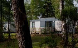 Huuraccommodaties - Cottage Taos Vip Prestige - Airotel Camping Domaine Lac de Miel