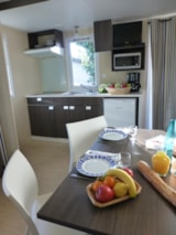 Rental - Mobile home 'Ciel' 21m² + 1 bedroom + terrace partly covered 11m² - Camping L'Eden