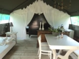 Rental - Desert Tent Mojave 50 m² with electricity, wood terrace - La Parenthèse - Camping Les Ormes