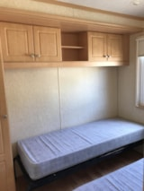 Rental - Mobile home PREMIUM 38m2 /3 bedrooms / covered terrace / air conditionner / TV - Camping La Buissiere