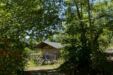 Rental - Furnished tent SAFARI WOODLODGE 59m² / 2 bedrooms - sheltered terrace (with private facilities) - Camping Domaine de  La SERRE