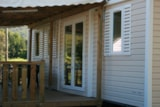 Rental - MOBIL-HOME COUFLENS : bathroom with covered terrace - Camping Les 4 Saisons