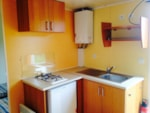 Rental - The small bungalows: Le Guitou 18 m², 2 bedrooms - Camping LE RUISSEAU